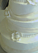 Smoothed Buttercream Icing with Fondant Sash Cascade Wedding Cake